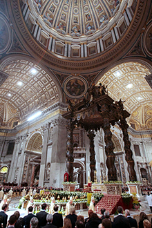 Faithful gather in St. Peter's Basilica during the Easter Vigil mass celebrated by Pope Benedict XVI, at the Vatican, Saturday, April 23, 2011. The pontif began Saturday night's ceremony by lighting a candle that symbolizes the resurrection of Christ, which the faithful mark on Easter Sunday. (AP Photo/Gregorio Borgia)
