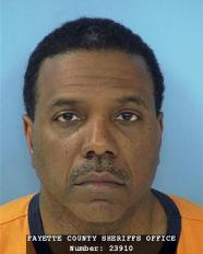This Friday, June 8, 2012 photo provided by the Fayette County Sheriff's Office shows megachurch pastor Creflo Dollar. Dollar has been arrested after authorities say he slightly hurt his 15-year-old daughter in a fight at his metro Atlanta home. Fayette County Sheriff's Office investigator Brent Rowan says deputies responded to a call of domestic violence at the home around 1 a.m. Friday. Rowan says the 50-year-old pastor and his daughter were arguing over whether she could go to a party when Dollar 'got physical' with her, leaving her with 'superficial injuries.' (AP Photo/Fayette County Sheriff's Office)