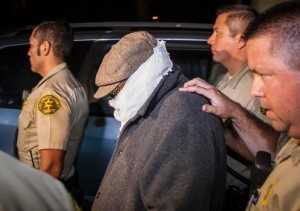 Nakoula Basseley Nakoula (C) is escorted out of his home by Los Angeles County Sheriff's officers in Cerritos, California September 15, 2012. Bret Hartman / Reuters, via the (NY) Daily News.