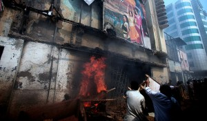 Protesters set a cinema ablaze on Friday in Peshawar, Pakistan. Violence there began early, and two people, including a television station employee, were killed. Mohammad Sajjad/Associated Press,via the NY Times.