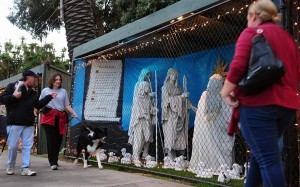 In this file photo taken on Dec. 17, 2011, pedestrians walk past a Christmas display in Santa Monica, California. Frederic J. Brown / AFP - Getty Images file.