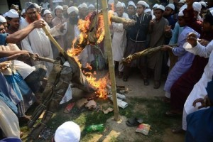 Supporters of Islamic political parties burn and kick an effigy of a blogger inside a madrassa, or religious school, during a nationwide strike in Dhaka on February 24, 2013. Islamists demanding the execution of bloggers they accuse of blasphemy clashed with police in Bangladesh for a third straight day Sunday, and at least four protesters were killed when police opened fire (AFP Photo)