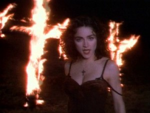 Madonna in the music video for 'Like a Prayer', in one of the most controversial scenes, displaying the burning crosses, via Wikipedia