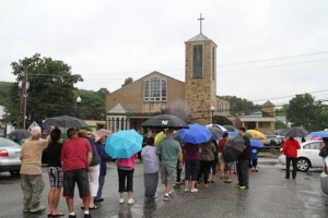 People who got out of their cars form a line to get a look at the cross atop the Church of the Presentation of the Blessed Virgin Mary (Sandor Bodo/The Providence Journal)