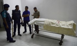 Police stand with the body of Faisal Arefin Deepan, a publisher of secular books. Photograph: Munir Uz Zaman/AFP/Getty Images, via the Guardian