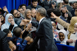 President Obama greeted families in an overflow room after speaking at the Islamic Society of Baltimore mosque. / Drew Angerer for the New York Times