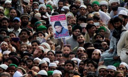 Supporters of Mumtaz Qadri during his funeral. Photograph: Anjum Naveed/AP, via The Guardian