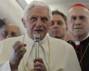 Pope Benedict XVI talks to journalists during a press conference aboard the airplane, Tuesday, May 11, 2010, on the way to Lisbon for his four day visit to Portugal. (AP Photo/Gregorio Borgia)