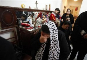A Coptic Orthodox Christian cries for her relatives who were victims of Saturday's bomb attacks outside a Coptic Orthodox church, during a prayer ceremony at a home in Alexandria January 3, 2011. REUTERS/Asmaa Waguih