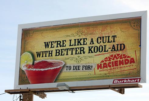 Hacienda restaurants has apologized and plans to pull down billboards like this in South Bend, Ind., after complaints about the tie-in to the Jonestown cult deaths. Mike Hartman, South Bend Tribune.