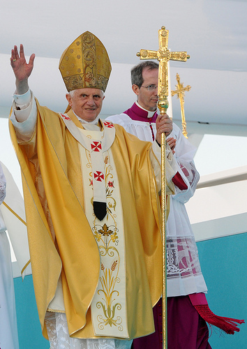 Pope Benedict XVI waves to the crowd as he arrives for an open-air mass in the Terreiro do Paso in Lisbon, on May 11, 2010