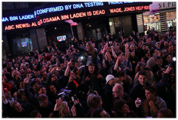 In Times Square, hundreds gathered to celebrate and watch the news flash across the big screens. Credit: Michael Appleton for The New York Times