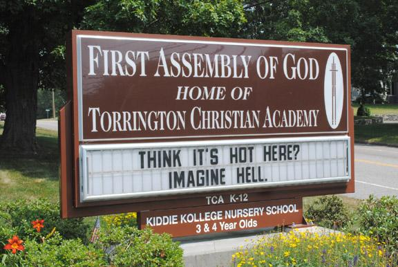 MIKE AGOGLIATI / Register Citizen / A sign of the times. This sign at the First Assembly of God Church on New Harwinton Road offers advice for keeping cool in the summer heat. 'Think it's hot here? Imagine Hell.'