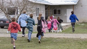 Children run back to class following a recess at Mormon Hills School in the polygamous community of Bountiful, B.C. (Jonathan Hayward/Canadian Press) via CBC