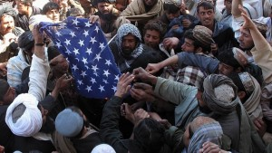 Afghan demonstrators destroy a U.S. flag during a protest against Quran desecration in Helmand province, Feb. 23, 2012. (Getty)