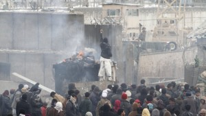 Afghan protesters in front of Bagram Air Base during an anti-U.S. demonstration, Feb. 21, 2012. (AP)