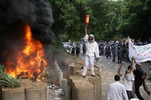 NBC News / Protesters clash with security forces after setting a fire at the German Embassy in Khartoum, Sudan, on Friday
