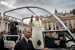 Pope Francis greets crowds during a papal mass marking the closing of the Year of Faith. Francesco Zizola—NOOR for TIME.