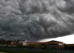 Storm clouds gather over the scene outside the Jewish Community Center, 5801 W. 115th Street in Leawood, Ks, following a shooting on Sunday, April 13, 2014. / John Sleezer, the Kansas City Star
