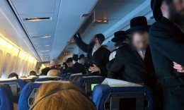 Haredi crowd aisle after refusing to sit next to women on flight /  Photo Credit: Amit Ben Natan, via Shalom Life