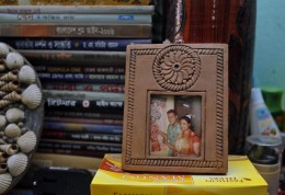 A photo frame displaying portraits of blogger Niloy Chowdhury, 40, with his wife is placed inside their room in Dhaka, Bangladesh, Friday, Aug. 7, 2015. Assailants believed to be Islamist militants entered an apartment building posing as potential tenants and killed the secular blogger in Bangladesh's capital on Friday, in the fourth such deadly attack this year, police said. (AP Photo/A.M. Ahad)