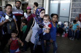 Slovakia Christian asylum seekers: Syrian refugees wait for a train to take them to the northern city of Thessaloniki, in Athens, Greece, August 20, 2015. / Alkis Konstantinidis, Newsweek