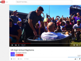 A Youtube video shows a mass baptism at Villa Rica High School from August 17th. (Photo: YouTube, via WXIA-TV)