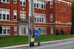 Stacey Wendell ties a ribbon around a telephone pole in front of the Word of Life Church, in Chadwicks, as a memorial for the two teenage Leonard brothers who were beaten at the church on Oct 12. Lucas Leonard, 19, was killed, his brother Christopher has been released from the hospital. Wendell is the organizer of the vigil being held for the two at St. Patrick's St. Anthony's Church in Chadwicks. Michael Greenlar (mgreenlar@syracuse.com) / The Post-Dispatch
