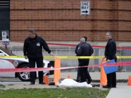 Police cover the body of a suspect outside Watts Hall on the campus of Ohio State University in Columbus, Ohio, following an attack on campus that left several people injured on Monday, Nov. 28, 2016. The man, identified as Abdul Razak Ali Artan, plowed his car into a group of pedestrians and began stabbing people with a butcher knife Monday before he was shot to death by a police officer. (Photo: Adam Cairns, AP / via USA Today)