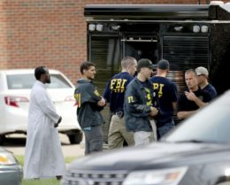 Law enforcement officials investigate an explosion at the Dar Al-Farooq Islamic Center in Bloomington, Minn., on Saturday, Aug. 5, 2017. Bloomington police Chief Jeff Potts said Saturday that investigators are trying to determine the cause of the blast. Authorities say the explosion damaged one room but it didn't hurt anyone. (David Joles, Star Tribune)