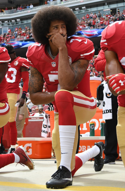 Colin Kaepernick of the San Francisco 49ers kneels on the sideline during the anthem prior to the game against the Dallas Cowboys on October 2, 2016 in Santa Clara, California. (Photo by Thearon W. Henderson/Getty Images)