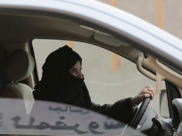 In this Saturday, March 29, 2014 file photo, Aziza Yousef drives a car on a highway in Riyadh, Saudi Arabia, as part of a campaign to defy Saudi Arabia's ban on women driving. Saudi Arabia says it will allow women to drive for the first time in the ultra-conservative kingdom. The kingdom, which announced the change on Tuesday, Sept. 26, 2017, was the only the country in the world to bar women from driving and for years had garnered negative publicity internationally for detaining women who defied the ban. (AP Photo/Hasan Jamali, File)