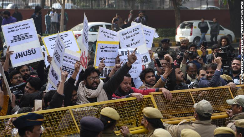 Dalit demonstrators shout slogans and protest in the Indian capital New Delhi, on January 3, 2018. / CNN