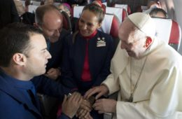 Pope Francis marries flight attendants Carlos Ciuffardi, left, and Paola Podest, center, during a flight from Santiago, Chile, to Iquique, Chile, Thursday, Jan. 18, 2018. Pope Francis celebrated the first-ever airborne papal wedding, marrying these two flight attendants from Chile's flagship airline during the flight. The couple had been married civilly in 2010, however, they said they couldn't follow-up with a church ceremony because of the 2010 earthquake that hit Chile. (Credit: L'Osservatore Romano Vatican Media/Pool Photo via AP.)